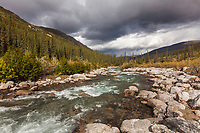 Rain clouds form over the Arrigetch Creek, Gates of the Arctic National Park, Alaska.