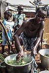CAR, Bangui: A woman is cooking manioc in the Mpoko camp. The IDP's from the camp are cultivating their own gardens in order to have enough food.  17th April 2016.<br /> <br /> RCA, Bangui : Une femme fait cuire du manioc dans le camp Mpoko . Les déplacés  du camp cultivent leurs propres jardins afin d'avoir assez de nourriture . 17 avril 2016.