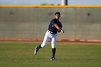 AZL Indians Red right fielder Jean Montero (15) warms up between innings of an Arizona League game against the AZL Padres 1 on June 23, 2019 at the Cleveland Indians Training Complex in Goodyear, Arizona. AZL Indians Red defeated the AZL Padres 1 3-2. (Zachary Lucy/Four Seam Images)