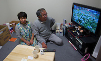 Takeo Sasaki,63, and his wife in their new temporary housing that comes with flat screen TV,  air conditioner, microwave, oven, fitted bathroom in Minamisanriku, Myiagi, Japan. The fishing port of Minamisanriku, Miyagi, Japan was devastated by the tsunami where the popultion was reduced from 18,000 to about 8,000
