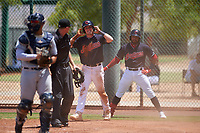 AZL Indians Blue Ike Freeman (12) and Aaron Bracho (7) disagree with a call from home plate umpire Bailey Dutten during an Arizona League game against the AZL Indians Red on July 7, 2019 at the Cleveland Indians Spring Training Complex in Goodyear, Arizona. The AZL Indians Blue defeated the AZL Indians Red 5-4. (Zachary Lucy/Four Seam Images)