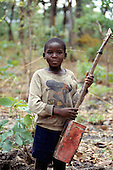Livingstone Memorial, Zambia. Boy playing with a home - made toy/guitar from recycled material.