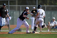 UW-Stout Blue Devils Jake Johnson (18) stretches for a throw as Pat Manning (4) runs through the bag during the first game of a doubleheader against the Edgewood Eagles on March 16, 2015 at Lee County Player Development Complex in Fort Myers, Florida.  UW-Stout defeated Edgewood 6-1.  (Mike Janes/Four Seam Images)