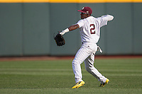 Mississippi State outfielder Demarcus Henderson (2) makes a throw from the outfield during Game 1 of the 2013 Men's College World Series Finals against the UCLA Bruins on June 24, 2013 at TD Ameritrade Park in Omaha, Nebraska. The Bruins defeated the Bulldogs 3-1, taking a 1-0 lead in the best of 3 series. (Andrew Woolley/Four Seam Images)