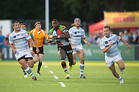 20130803 Copyright onEdition 2013 ©<br />Free for editorial use image, please credit: onEdition.<br /><br />Patrice Agunda of Harlequins 7s runs away from Gerard Ellis of London Irish 7s (left) to score a try during the J.P. Morgan Asset Management Premiership Rugby 7s Series.<br /><br />The J.P. Morgan Asset Management Premiership Rugby 7s Series kicks off for the fourth season on Thursday 1st August with Pool A at Kingsholm, Gloucester with Pool B being played at Franklin's Gardens, Northampton on Friday 2nd August, Pool C at Allianz Park, Saracens home ground, on Saturday 3rd August and the Final being played at The Recreation Ground, Bath on Friday 9th August. The innovative tournament, which involves all 12 Premiership Rugby clubs, offers a fantastic platform for some of the country's finest young athletes to be exposed to the excitement, pressures and skills required to compete at an elite level.<br /><br />The 12 Premiership Rugby clubs are divided into three groups for the tournament, with the winner and runner up of each regional event going through to the Final. There are six games each evening, with each match consisting of two 7 minute halves with a 2 minute break at half time.<br /><br />For additional images please go to: http://www.w-w-i.com/jp_morgan_premiership_sevens/<br /><br />For press contacts contact: Beth Begg at brandRapport on D: +44 (0)20 7932 5813 M: +44 (0)7900 88231 E: BBegg@brand-rapport.com<br /><br />If you require a higher resolution image or you have any other onEdition photographic enquiries, please contact onEdition on 0845 900 2 900 or email info@onEdition.com<br />This image is copyright the onEdition 2013©.<br /><br />This image has been supplied by onEdition and must be credited onEdition. The author is asserting his full Moral rights in relation to the publication of this image. Rights for onward transmission of any image or file is not granted or implied. Changing or deleting Copyright information is illegal as specified in