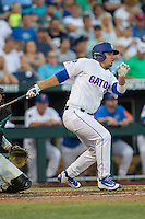 Florida Gators pinch hitter Jeremy Vasquez (24) follows through on his swing against the Coastal Carolina Chanticleers in Game 4 of the NCAA College World Series on June 19, 2016 at TD Ameritrade Park in Omaha, Nebraska. Coastal Carolina defeated Florida 2-1. (Andrew Woolley/Four Seam Images)