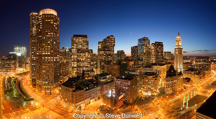 Downtown night skyline from Harbor Towers, Boston, MA with crescent moon,  panorama