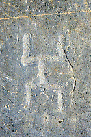 Petroglyph, rock carving, of what is known as a praying man carved by the Camunni people in the iron age between 1000-1600 BC, Rock no 1, Riserva Naturale Incisioni Rupestri di Ceto, Cimbergo e Paspardo, Capo di Ponti, Valcamonica (Val Camonica), Lombardy plain, Italy