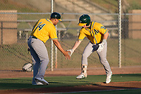 AZL Athletics second baseman Nick Ward (4) is congratulated by manager Eddie Menchaca (14) after a home run in his first professional at bat during an Arizona League game against the AZL Giants Black at the San Francisco Giants Training Complex on June 19, 2018 in Scottsdale, Arizona. AZL Athletics defeated AZL Giants Black 8-3. (Zachary Lucy/Four Seam Images)