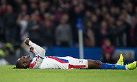 A downbeat Wilfried Zaha of Crystal Palace during the Premier League match between Chelsea and Crystal Palace at Stamford Bridge, London, England on 4 November 2018. Photo by Andy Rowland.<br /> .<br /> (Photograph May Only Be Used For Newspaper And/Or Magazine Editorial Purposes. www.football-dataco.com)
