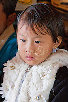 Myanmar, Burma.  Pre-school Burmese Girl of Intha Ethnic Group, Inle Lake, Shan State.  She has thanaka paste on her face, a cosmetic sunscreen.