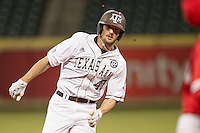 Texas A&M Aggie outfielder Jonathan Moroney #40 hustles towards third base against the Houston Cougars in the NCAA baseball game on March 1st, 2013 at Minute Maid Park in Houston, Texas. Houston defeated Texas A&M 7-6. (Andrew Woolley/Four Seam Images).