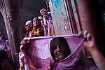 A lady covers her up with a veil during celebrating Holi at Banke Bihari temple in Vrindavan. Holi is the Hindu festival of colours. Every year at the begining of spring this festival takes place throughout India.The biggest celebration takes place in Banke Bihari temple Vrindavan.