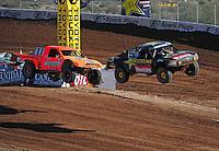 Dec. 10, 2011; Chandler, AZ, USA;  LOORRS pro 4 unlimited driver Kyle LeDuc (99) and Adrian Cenni (11) during round 15 at Firebird International Raceway. Mandatory Credit: Mark J. Rebilas-