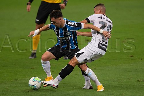 14th November 2020; Arena de Gremio, Porto Alegre, Brazil; Brazilian Serie A, Gremio versus Ceara; Pepe of Gremio beats the tackle from Kelvyn of Ceara