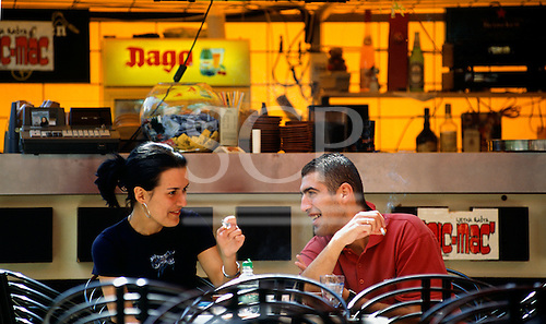Sarajevo, Bosnia. Young smiling couple at a street cafe.