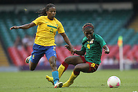 FORMIGA of Brazil chases Madeleine NGONO MANI of Cameroon - Brazil Women vs Cameroon Women - Womens Olympic Football Tournament London 2012 Group E at the Millenium Stadium, Cardiff, Wales - 25/07/12 - MANDATORY CREDIT: Gavin Ellis/SHEKICKS/TGSPHOTO - Self billing applies where appropriate - 0845 094 6026 - contact@tgsphoto.co.uk - NO UNPAID USE.