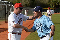 Ball State Cardinals head coach Rich Maloney (2) shakes hands with Steve Trimper (4) before a game against the Maine Black Bears on March 3, 2015 at North Charlotte Regional Park in Port Charlotte, Florida.  Ball State defeated Maine 8-7.  (Mike Janes/Four Seam Images)