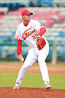 Pitcher Chen Kun (33) of the China National Team during a game vs. the Houston Astros Instructional League team at Holman Stadium in Vero Beach, Florida September 28, 2010.   China is in Florida training for the Asia games which will be played in Guangzhou, China in November.  Photo By Mike Janes/Four Seam Images