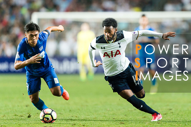 Tottenham Hotspur midfielder Georges-Kevin Nkoudou (R) dribles SC Kitchee Midfielder Yang Huang (L) during the Friendly match between Kitchee SC and Tottenham Hotspur FC at Hong Kong Stadium on May 26, 2017 in So Kon Po, Hong Kong. Photo by Man yuen Li  / Power Sport Images