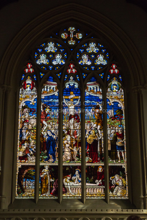 UK, England, Cambridge.  Corpus Christi Chapel,  19th-century English Stained Glass showing the Crucifixion.  Bottom detail shows washing the body of Jesus.