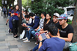 Shoppers wait in line at the Apple Store in Tokyo's Omotesando shopping district in Japan on September 22, 2017. Apple Inc.'s new iPhone 8 and iPhone 8 Plus smartphones went on sale in Japan. (Photo by YUTAKA/AFLO)