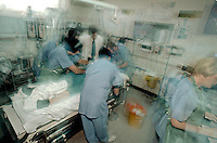 Patient with a suspect heart attack being attended to by doctors and nurses in the crash room of an accident and emergency department in hospital. This image may only be used to portray the subject in a positive manner..©shoutpictures.com..john@shoutpictures.com