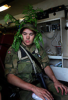 A soldier in simulated chock is treated inside an ambulance. Norwegian Home Guard soldiers during exercise Djerv..The Home Guard has traditionally been designated to secure important  domestic installations in case of war or crisis. With the cold war long gone, a war in Afghanistan and budget cuts, there is a debate over the Home Guard's role in the future.
