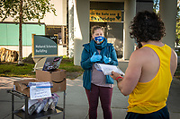 Geological Sciences term instructor Janelle Sikorski hands out packages of rock and mineral samples beside the UAA Geologic Rock Garden so that students taking introductory geology students can get hands-on with their distance learning. 80% of UAA's courses this semester will be delivered via distance learning as the COVID-19 pandemic continues.