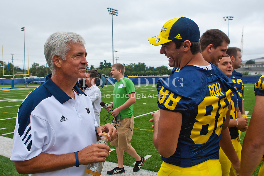 Michigan defensive coordinator Greg Robinson, left, chats with linebacker Craig Roh (88) at the annual NCAA college football media day, Sunday, Aug. 22, 2010, in Ann Arbor, Mich. (AP Photo/Tony Ding)