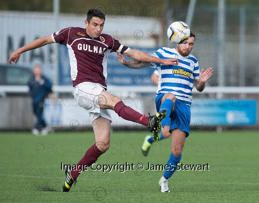 Stenny's Ross McMillan clears from Morton's Jamie McCluskey .