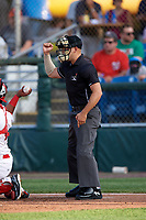 Umpire David Cruz calls a strike during a game between the Lowell Spinners and Auburn Doubledays on July 13, 2018 at Falcon Park in Auburn, New York.  Lowell defeated Auburn 8-5.  (Mike Janes/Four Seam Images)
