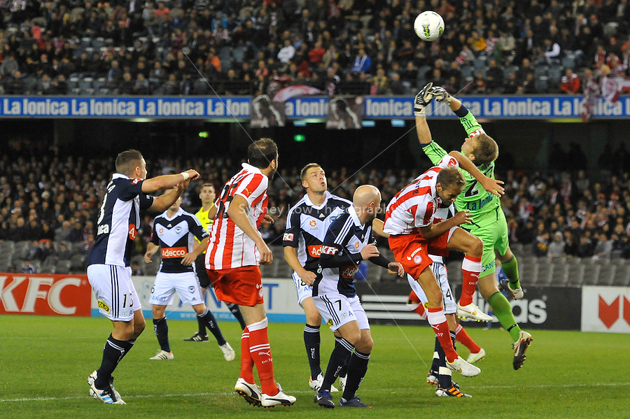 MELBOURNE, AUSTRALIA - MAY 19: Lawrence Thomas of the Victory jumps for the ball during a match between Melbourne Victory and Olympiakos FC at Etihad Stadium on 19 May 2012 in Melbourne, Australia. (Photo Sydney Low / AsteriskImages.com)