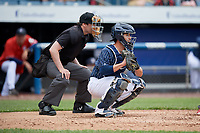Syracuse Chiefs catcher Tuffy Gosewisch (11) in front of home plate umpire Scott Costello during a game against the Lehigh Valley IronPigs on May 20, 2018 at NBT Bank Stadium in Syracuse, New York.  Lehigh Valley defeated Syracuse 5-2.  (Mike Janes/Four Seam Images)