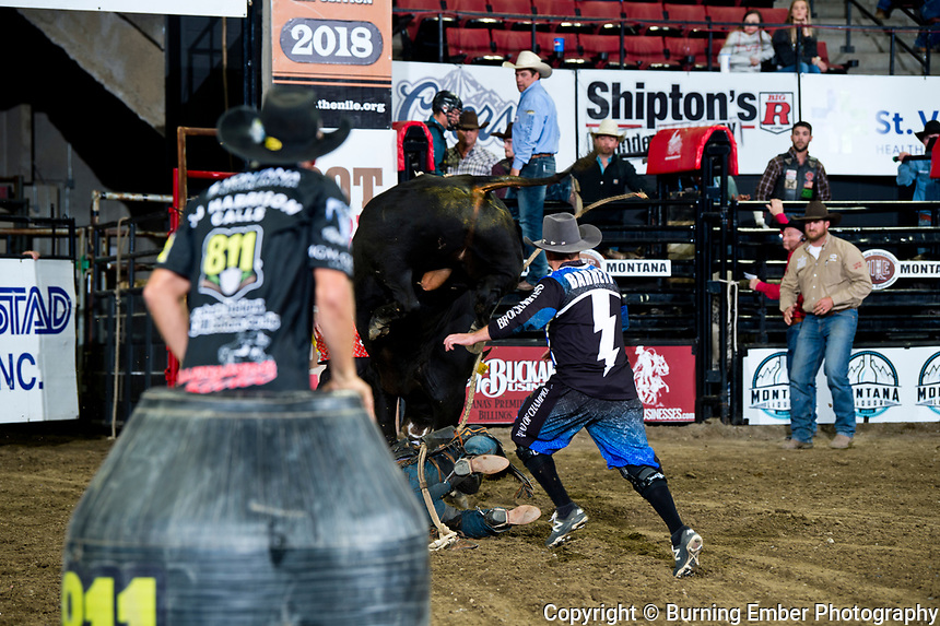 Tyler Bingham takes cover as JJ Harrison watches Kaleb Barrett step in on D&H Cattle Co's John Jr at the NILE PRCA 1st perf Event. October 18th, 2018.  Photo by Josh Homer/Burning Ember Photography.  Photo credit must be given on all uses.