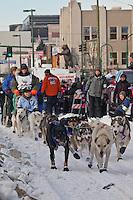 Musher Ellen Halverson and Iditarider  Gail Harbin.leave the 2011 Iditarod ceremonial start line in downtown Anchorage, Alaska