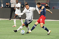 FOXBOROUGH, MA - OCTOBER 19: Matt Polster #8 of New England Revolution passes the ball as Ilsinho #25 of Philadelphia Union comes in to tackle during a game between Philadelphia Union and New England Revolution at Gillette on October 19, 2020 in Foxborough, Massachusetts.
