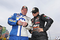 Apr. 6, 2013; Las Vegas, NV, USA: NHRA pro stock driver Allen Johnson (left) looks at his time slip with runner-up Erica Enders-Stevens after winning the K&N Horsepower Challenge during qualifying for the Summitracing.com Nationals at the Strip at Las Vegas Motor Speedway. Mandatory Credit: Mark J. Rebilas-