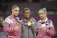 London, England - Thursday, August 2, 2012: USA's Gabrielle Douglas, center, wins gold in the women's gymnastics individual all around at the London 2012 Summer, Olympic Games, North Greenwich Arena, London. She poses with Russian silver medalist, Victoria Komova, and Russian bronze medalist Aliya Mustafina..