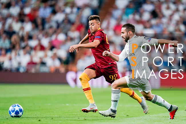 Stephan El Shaarawy of Roma (L) fights for the ball with Daniel Carvajal Ramos of Real Madrid (R) during the UEFA Champions League 2018-19 match between Real Madrid and Roma at Estadio Santiago Bernabeu on September 19 2018 in Madrid, Spain. Photo by Diego Souto / Power Sport Images