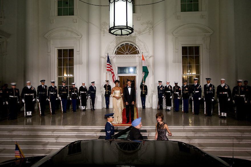 U.S. President Barack Obama and first lady Michelle Obama await the arrival of India's Prime Minister Manmohan Singh and his wife Gursharan Kaur for a state dinner on the North Portico of the White House.................