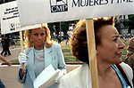 Economic Turmoil in Argentina<br /> Members of PYME which is a womens small and middle size business organisation wear white gloves, and are dressed in blue and white Argentinean colours, as they demonstrate against the banking restrictions in Plaza de Mayo. 2002 2000s