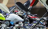 25 MAY 2014 - BRIGG, GBR - Bike helmets rest on bikes and paddles lean against the racking in transition during the World Quadrathlon Federation 2014 Middle Distance World Championships at the Brigg Bomber at Brigg in Lincolnshire, Great Britain (PHOTO COPYRIGHT © 2014 NIGEL FARROW, ALL RIGHTS RESERVED)
