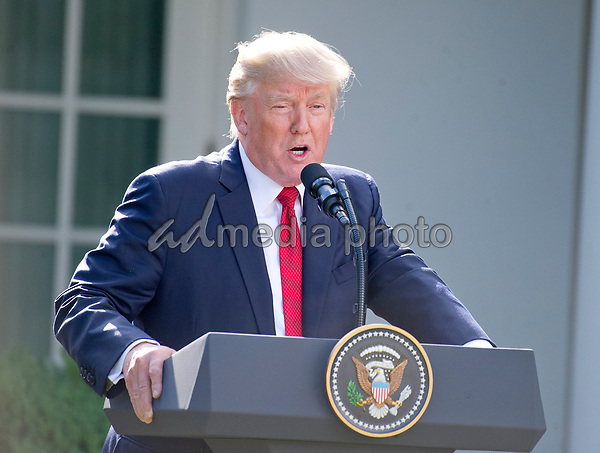United States President Donald J. Trump delivers a joint statement with Prime Minister Narendra Modi of India in the Rose Garden of the White House in Washington, DC on Monday, June 26, 2017. Photo Credit: Ron Sachs/CNP/AdMedia