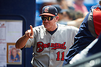 Brevard County Manatees manager Joe Ayrault (11) jokes with players on the bench during a game against the St. Lucie Mets on April 17, 2016 at Tradition Field in Port St. Lucie, Florida.  Brevard County defeated St. Lucie 13-0.  (Mike Janes/Four Seam Images)
