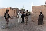 12/08/14  Iraq -- Daquq, Iraq -- Peshmerga fighters with civilians in the village outside the base in Daquq.