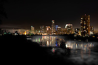 A frigid winter's night finds the Austin Skyline as fog rises from Town Lake Austin, Texas