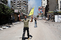 Beirut, Lebanon, Aug 14 2006.The mood is jubilant  as the Hezbollah is perceived to have come up the winner of the confrontation. Mere hours after the beginning of the cease-fire, thousands of inhabitants return to Hareit Hreik, the main Hezbollah stronghold in the capital, constantly targeted by Israeli air force bombing raids during 33 days and almost totally destroyed as a result.