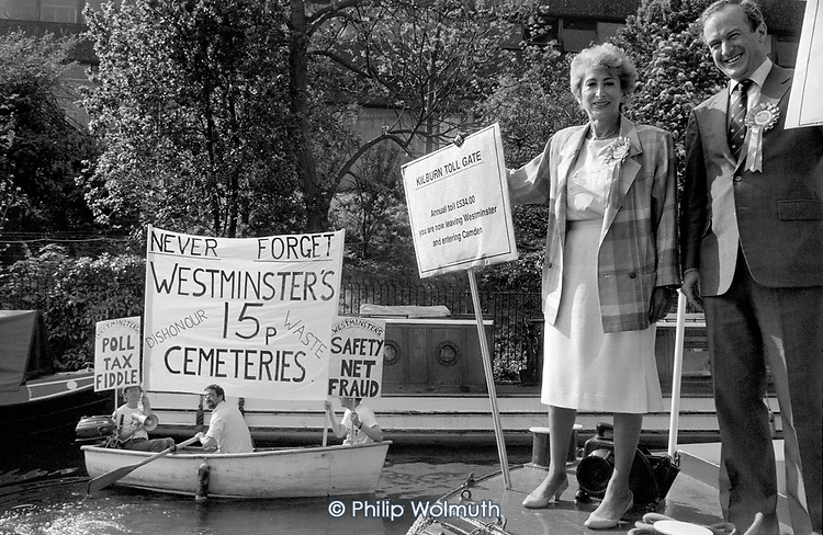 Demonstrators rotesting at the sale of three cemeteries by Westminster City Council for 15p disrupt a local election photo call attended by Dame Shirley Porter and Environment Minister David Hunt on the Regents Canal.