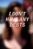 """Anonymous portrait taken in Cambridge, Massachusetts, USA,  paired with text answering the question: How much do you owe?  The project was produced as a look at personal debt for Longshot Magazine #2.  ..The person's response here reads: """"I don't have any debts"""""""
